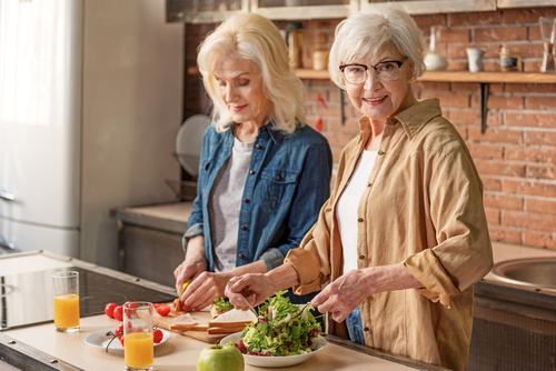 Cheerful mature ladies caring of their health