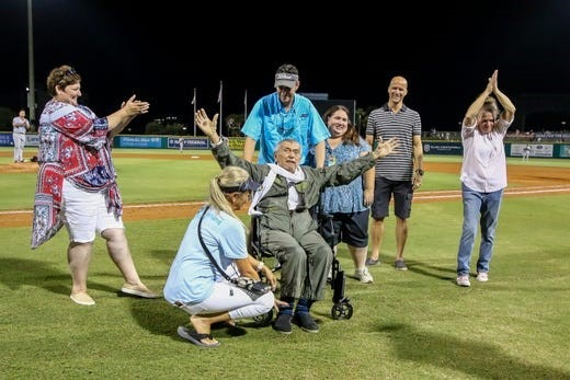 Captain Lane in wheel chair with 6 friends at Wahoos Stadium. Covenant Care