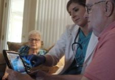 Nurse with family showing RPM device